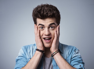 Terrified teenager head in hands