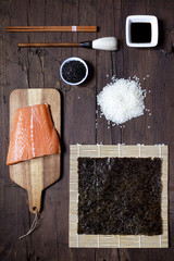 overhead shot of ingredients for sushi on wooden table
