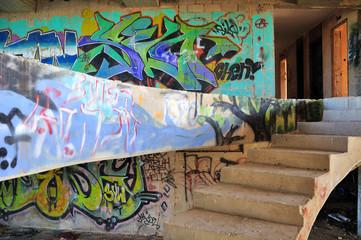 Abandoned building covered with graffiti near Jerusalem.