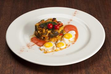 Spanish pisto or ratatouille  with quail eggs