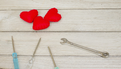 Vintage love repair,Red Heart and a screwdriver on the wood