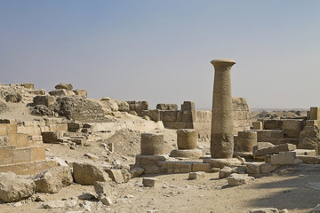 ancient column among ruins in Giza