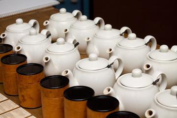 porcelain teapots with tea