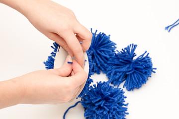 tie blue pompom middle thread