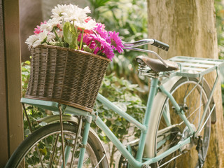 Vintage bicycle with flowers in basket