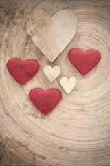 valentine's wooden hearts on a retro background