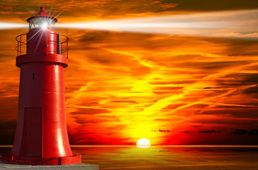 Photo sur Aluminium Phare Red Lighthouse with Light Beam at Sunset
