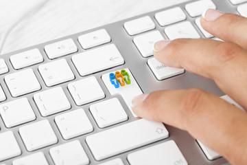 Woman pushing teamwork key on keyboard