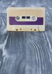 Music template postcard. Violet audio cassette