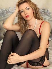 Beautiful Young Pin Up Model Posing on a Bed