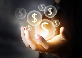 Money icon in business hand