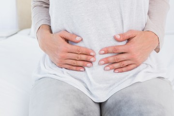 Mid section of woman with stomach pain