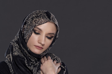 beautiful Muslim girl portrait isolated on dark background