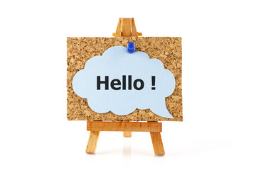 Wooden easel and blue speech bubble with word Hello !