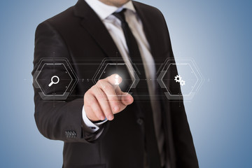 Businessman is pressing invisible virtual button