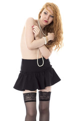 Young Woman Posing in a Short Black Mini Skirt and Stockings