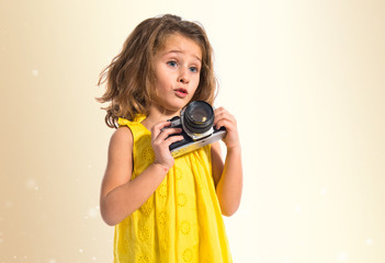 Blonde little girl photographing something