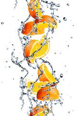 Foto op Plexiglas In het ijs Orange fruits and Splashing water