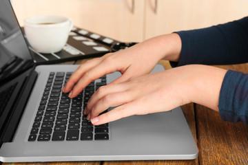 Female hands of scriptwriter working