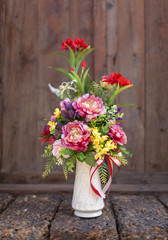 Beautiful colorful flower in tall vase