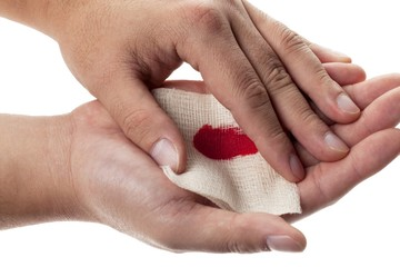 person holding medical bandage on bleeding palm