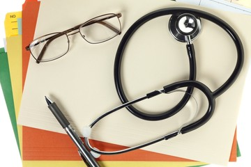 stethoscope with medical reports and spectacles