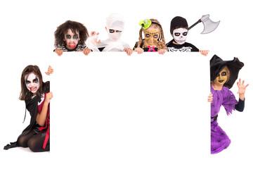 Kids in Halloween costumes Wall mural