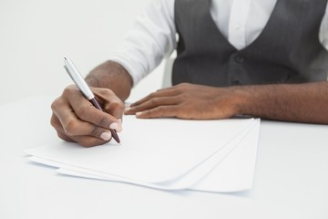 Businessman writing notes on paper