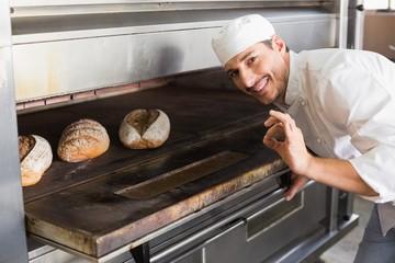 Happy baker by open oven