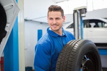 Mechanic holding a tire wheel