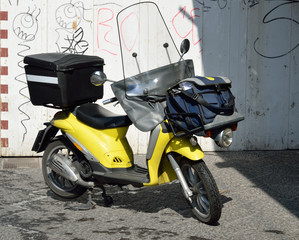 A modern scooter in the Italian city