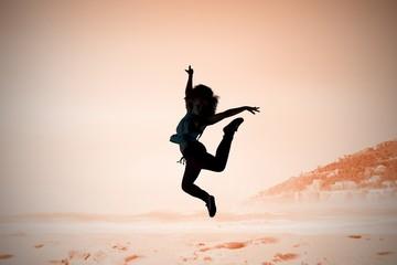 Composite image of pretty break dancer