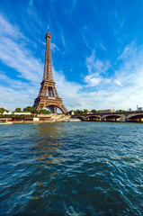 Eiffel Tower and Seine river with puffy clouds, Paris, France