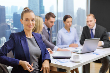 businesswoman over business team in office