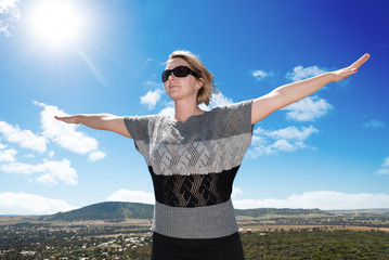 Woman spreading her arms on a sunny day