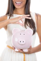 smiling business woman, bank employee holding piggy bank