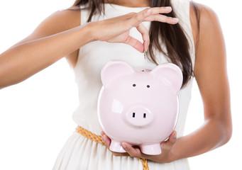Business woman, bank employee holding piggy bank
