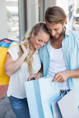 Attractive couple holding shopping bags