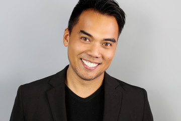 Young Filipino man smiling