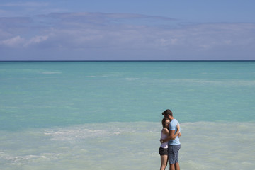 Happy couple a beach on holidays