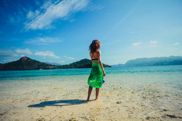 Woman wearing sarong on tropical beach