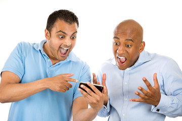 two men looking shocked with open mouth on cell mobile  phone