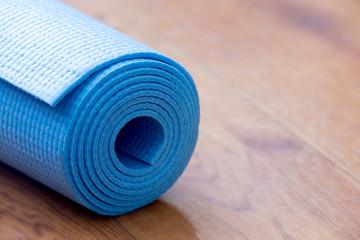 Rolled blue yoga mat