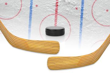 Two hockey sticks, puck and hockey field