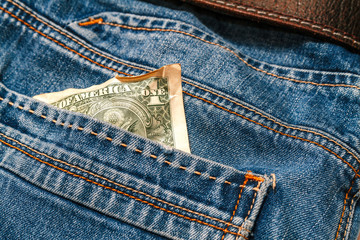 One crumpled dollar in your pocket jeans.Crisis, poverty concept