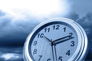 Clock on sky background