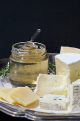 Cheese Plate with Cold White Wine Jelly in a Jar