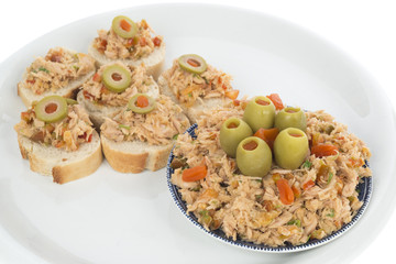 Bread with tuna salad topping on dish