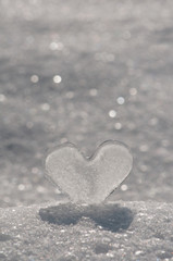 Ice heart in glittering snow.