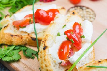 traditional Spanish tapas with cheese and tomatoes
